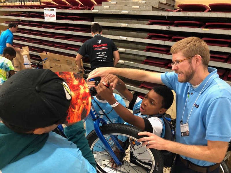 Brightspot employee volunteering at the YMCA's Thingamajig Invention Convention